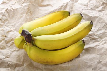 flesh colour: Bananas fresh bunch on crumpled paper
