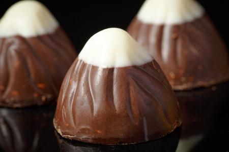 three chocolate truffle with white chocolate on top. Stock Photo