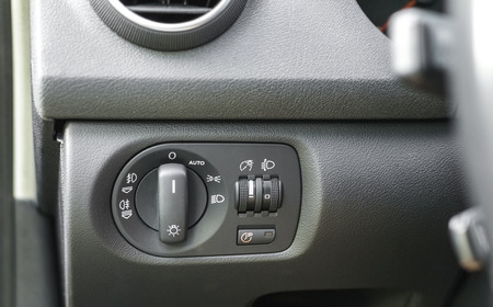 Close up shot of vehicle control panel for headlights, taillights, dashboard illumination and follow me home function.