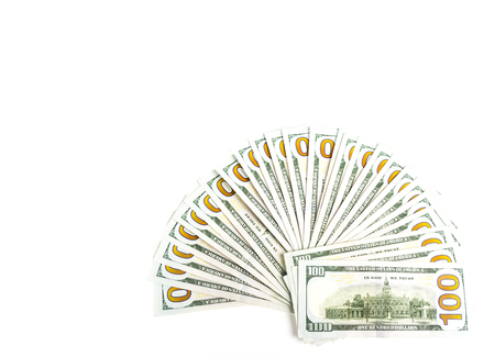 Money, vertical shot of american one hundred dollar bills isolated on white background sorted as widespread hand fan. Copy space. 스톡 콘텐츠