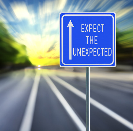 Expect the unexpected motivational phrase on blue road sign with arrow and blurred speedy background in sunset. Copy space.
