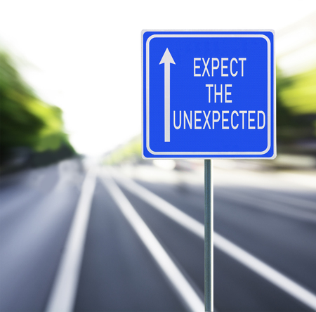Expect the unexpected motivational phrase on blue road sign with arrow and blurred speedy background. Copy space. Фото со стока