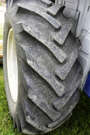 Worn out old tractor rear tyre ready to replace - Replacing tractor damaged tyre - Not safe for using tractor rear tyre