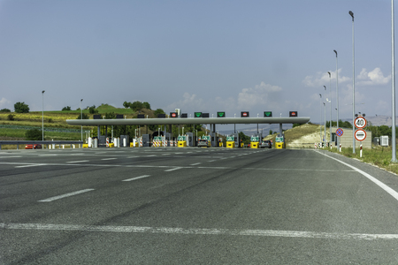 Pay toll check point - Toll booths at highway freeway autobahn 版權商用圖片