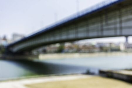 Blurred image of modern city bridge over the river of danube in belgrade serbia