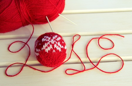knitted: New Years background with Christmas knitted ball