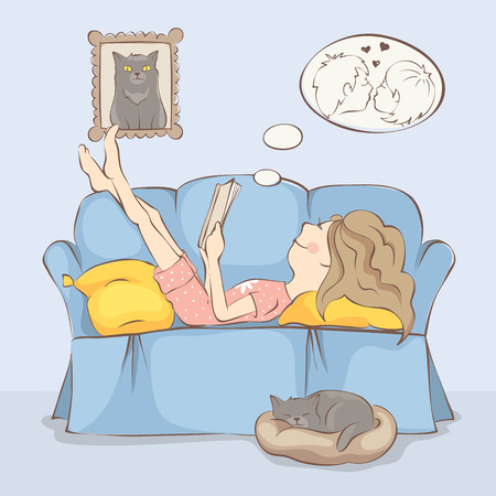 Woman reading a book/Young woman or girl is lying on the sofa reading a book, near cat sleeps