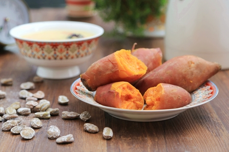 Sweet potatoes. Cooked whole and halved sweet potatoes