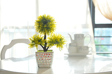 factitious: Decorative bouquet yellow artificial flowers in the hall