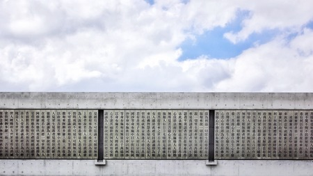The exterior walls of modern temples are inscribed with scriptures, and the grey of concrete precipitates the essence of thought. 写真素材