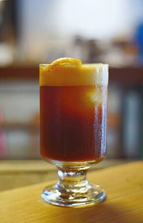 Ice black coffee and lemon mix in glass on foreground and soft blur for background