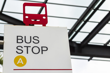 red bus shape on bus stop sign photo
