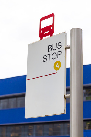bus station: red bus shape on bus stop sign