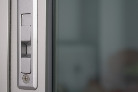 Close up aluminium door locked in apartmentcondominium. Stock Photo
