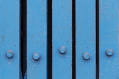 Close up old blue iron folding door at store front. Vintage background. Architecture detail.