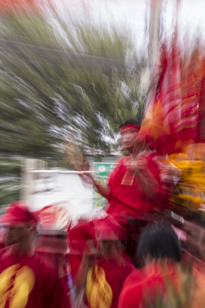 Thailand - FEBRUARY 20: Unidentified people in the parade at Chinese new year and vegetarian festival on FEBRUARY 20, 2015 in Nakhon Sawan Province - Thailand. Blurry background concept of religion and beliefs. Editorial