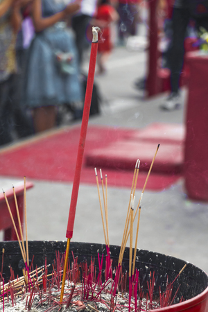 Many incense stick in incense burner with ashes. Some of the stalks are burning, Some of the stalks become ash gray, Asian countries popular incense to worship the holy thing.