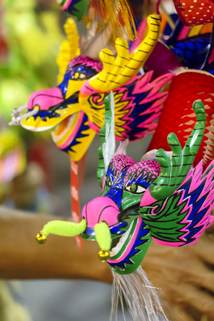 Dragon puppet paper mache handmade toy. Street photo china town Thailand.