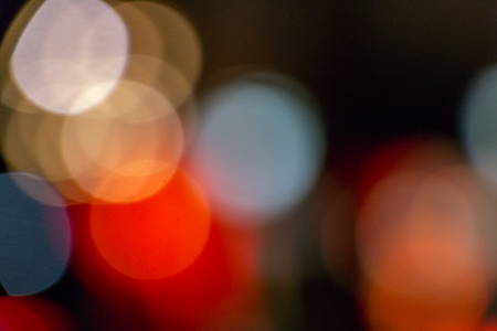 Night bokeh from light on the Road. Street light bokeh. Lights blurred bokeh background from christmas night party for your design. Stock Photo