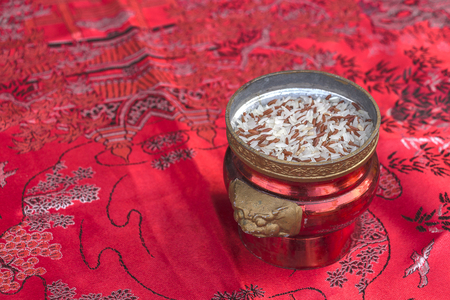 incense burner with rice on red fabric to celebrate in Chinese New year festival.
