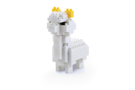 Toy alpaca made from toy plastic colorful blocks. Isolated with clipping path on white background.Perfect for illustrate element or background.