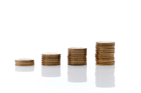 batch of euro: Four heaps of euro coins isolated on a white background
