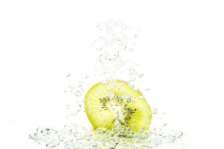 Green kiwi with water bubbles isolated on a white background