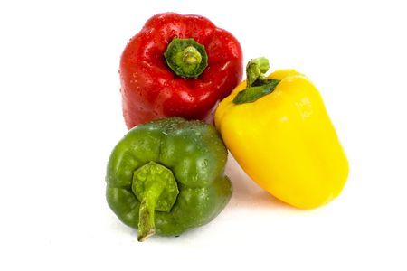 Green , red and yellow pepper on white background