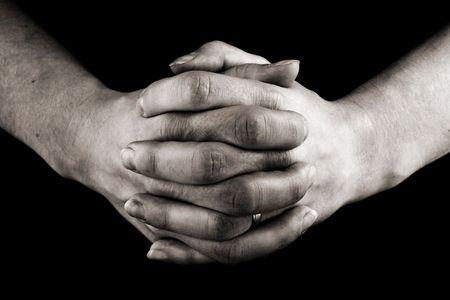 pentimento: femminile clasped mani in preghiera  Archivio Fotografico