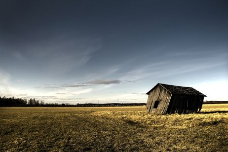 deserted haunted house on a empty field photo