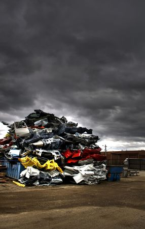 scrap heap: Pile of discarded cars on junkyard