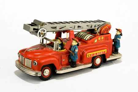 rare vintage fire truck toy isolated on white Stock Photo