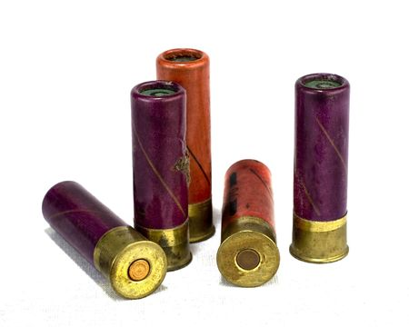 arsenal: isolated shotgun shells on white background