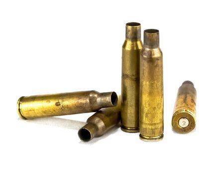 millimetres: used rifle ammunition on white background
