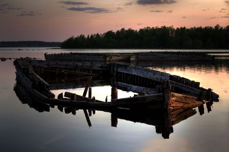 an old shipwreck in the light of the northern midnight sun photo