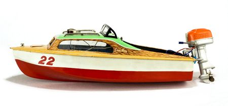collectable: rare vintage speedboat toy isolated on white