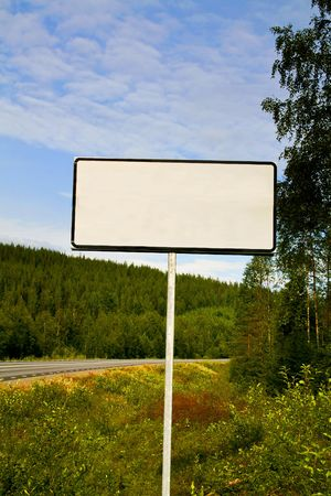 ad: blank white sign by an empty road Stock Photo