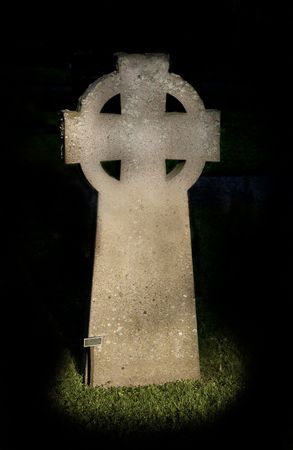 hereafter: an old celtic cross at grave yard Stock Photo