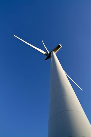 windpower: wind power turbine in front of a clear blue sky