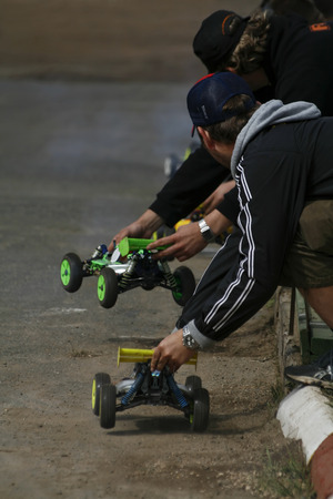 dirt track race with RC toy cars photo