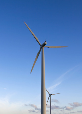 windpower: windpower turbines against a blue summer sky Stock Photo