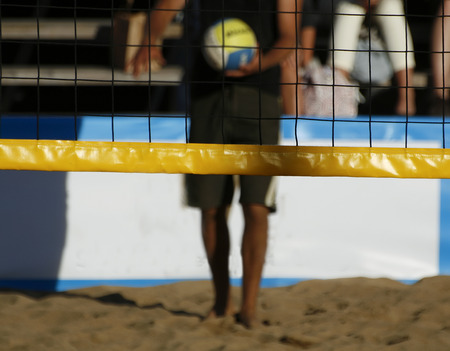 men playing a beach volleyball competition Stock Photo - 1470737
