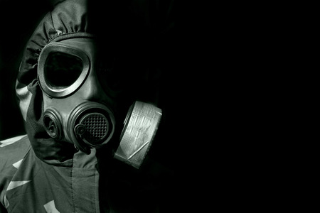 gas mask: military person wearing a gasmask and protective clothing Stock Photo