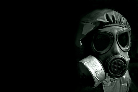 gasmask: military person wearing a gasmask and protective clothing Stock Photo