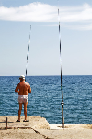 mediterranian: fishing in the mediterranian sea outside Barcelona, Spain Stock Photo