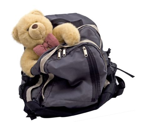 a back pack with a teddy bear - the luggage of a child with divorced parents Stock Photo