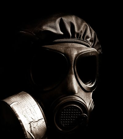 military person wearing a gasmask and protective clothing Stock Photo
