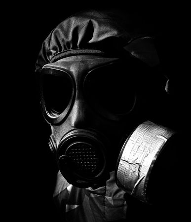 radium: military person wearing a gasmask and protective clothing Stock Photo