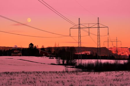 motionless: power lines in front of a winter sunset