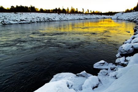 motionless: winter river scenery in the north of sweden